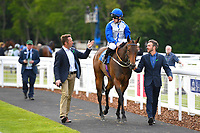 Winner of The Penang Turf Club Malaysia Handicap Chitra (blue) ridden by Richard Kingscote and trained by Daniel Kubler is led into the Winners enclosure during Afternoon Racing at Salisbury Racecourse on 16th May 2019
