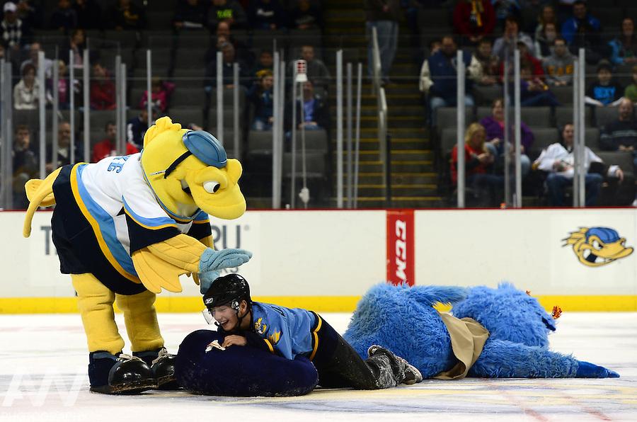 Oct 19, 2012; Toledo, OH, USA; Toledo Walleye mascot CatTrick and Spike against the Cincinnati Cyclones at Huntington Center: Mandatory Credit: Andrew Weber