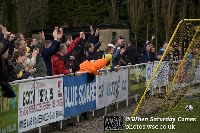 Southport fans celebrating their team's second goal scored by Chris Lever at the start of the second half against Harrogate Town at Wetherby Road, Harrogate. The Conference North match was won 3-2 by Southport, a result which kept the Sandgrounders on course for top spot in the division while Harrogate Town remained bottom.