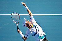 MELBOURNE, 14 JANUARY - Lleyton Hewitt (AUS) hits a serve in a match against Nikolay Davydenko (RUS) on day three of the 2011 AAMI Classic at Kooyong Tennis Club in Melbourne, Australia. (Photo Sydney Low / syd-low.com)
