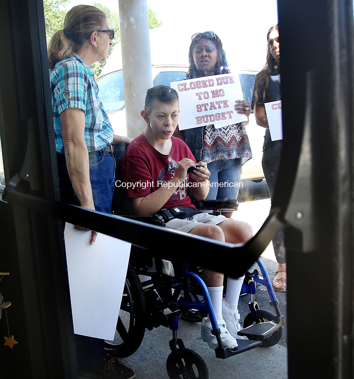 WATERBURY CT. 26 July 2017-072617SV01-Arline Moskaluk of Watertown with her son Robert Moskaluk  a client of Oak Hill Day Program on East Main Street can&rsquo;t enter the closed facility due to furlough day due to the state not having a budget. They speak to the press during a press conference at the facility in Waterbury Wednesday. Pamella Reid Johnson of a facility in Seymour ant right. <br /> Steven Valenti Republican-American