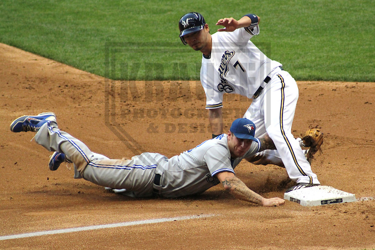 MILWAUKEE - June 2012: Brett Lawrie (13) of the Toronto Blue Jays tags out Norichika Aoki (7) of the Milwaukee Brewers during a game on June 18, 2012 at Miller Park in Milwaukee, Wisconsin. (Photo by Brad Krause). ..