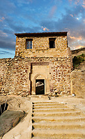 Picture &amp; image of main gate house of David Gareja Georgian Orthodox monastery, Mount Gareja, Kakheti Region, Georgia (country). 25 km (15 miles) from Gardabani<br /> <br /> Founded in the 6th century by David (St. David Garejeli), one of the  thirteen Assyrian monks who built monasteries throughout Georgia. The 24 plus monasteries of David Gareja are spread out over a huge area of the arid Mount Gareja ridge, with small cells and chapels cut into cliff faces.