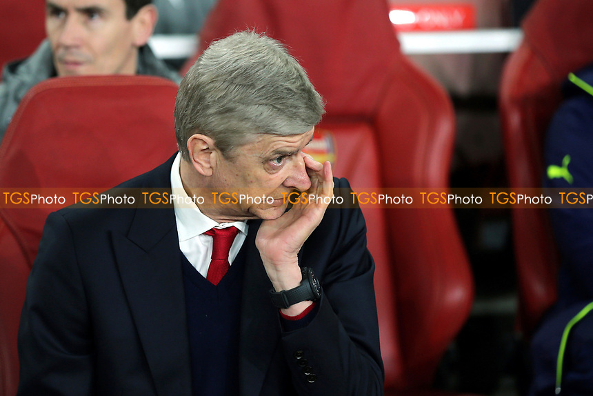 Arsenal Manager, Arsene Wenger, puts his hand to his eye during Arsenal vs FC Bayern Munich, UEFA Champions League Football at the Emirates Stadium on 7th March 2017