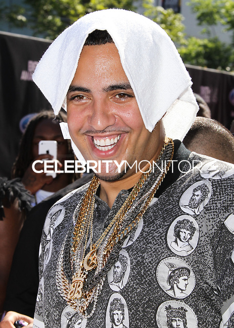 LOS ANGELES, CA, USA - JUNE 29: Rapper French Montana arrives at the 2014 BET Awards held at Nokia Theatre L.A. Live on June 29, 2014 in Los Angeles, California, United States. (Photo by Xavier Collin/Celebrity Monitor)