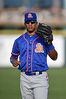 St. Lucie Mets outfielder Victor Cruzado (18) warms up before a game against the Bradenton Marauders on April 11, 2015 at McKechnie Field in Bradenton, Florida.  St. Lucie defeated Bradenton 3-2.  (Mike Janes/Four Seam Images)