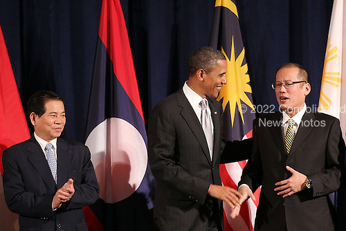 United States President Barack Obama (C) attends a working luncheon with ASEAN leaders Vietnam President Nguyen Minh Triet (L) and President of the Philippines Benigno Aquino III (R) Friday, September 24, 2010 in New York City. Obama has been in New York since Wednesday attending the annual General Assembly at the United Nations, where yesterday he stressed the need for a resolution between Israel and Palestine, and a renewed international effort to keep Iran from attaining nuclear weapons. .Credit: Spencer Platt - Pool via CNP