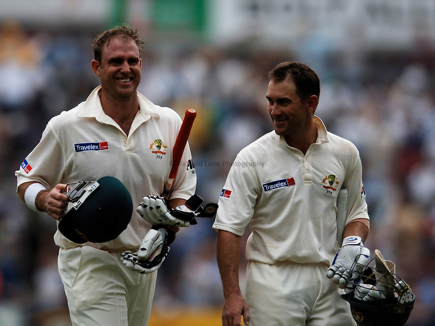 Photo: Glyn Thomas..England v Australia. nPower Test Series. The Ashes 2005..09/09/2005..Australia's opening batsmen Matthew Hayden (L) and Justin Langer leave the field after accepting the umpires' offer of bad light.