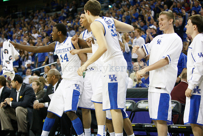 The UK bench cheers during the second half in the 2012 SEC Tournament championship game between Kentucky and Vanderbilt, played at New Orleans Arena, on 3/11/12.  Photo by Quianna Lige | Staff