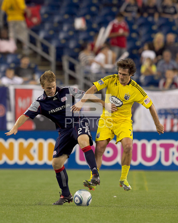 New England Revolution midfielder Seth Sinovic (27) attempts to control the ball while pressured by Columbus Crew forward Guillermo Barros Schelotto (7). The New England Revolution tied Columbus Crew, 2-2, at Gillette Stadium on September 25, 2010.