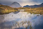 Isle of Skye, Scotland:<br /> Morning clouds clearing over the Cuillin mountains with reflections in a pond near Sligachan