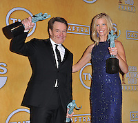 Bryan Cranston &amp; Anna Gunn at the 20th Annual Screen Actors Guild Awards at the Shrine Auditorium.<br /> January 18, 2014  Los Angeles, CA<br /> Picture: Paul Smith / Featureflash