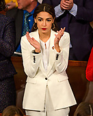 United States Representative Alexandria Ocasio-Cortez (Democrat of New York) applauds as US Representative Hakeem Jeffries (Democrat of New York) puts the name of Nancy Pelosi to be Speaker of the United States House of Representatives as the 116th Congress convenes for its opening session in the US House Chamber of the US Capitol in Washington, DC on Thursday, January 3, 2019.<br /> Credit: Ron Sachs / CNP<br /> (RESTRICTION: NO New York or New Jersey Newspapers or newspapers within a 75 mile radius of New York City)