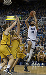 Nevada forward Caleb Martin (10) takes a jump shot against California Baptist in the first half of an NCAA college basketball game in Reno, Nev., Friday, Nov. 16, 2018. (AP Photo/Tom R. Smedes)
