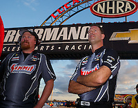 Sep 2, 2016; Clermont, IN, USA; NHRA pro stock driver Jason Line (right) with a crew member during qualifying for the US Nationals at Lucas Oil Raceway. Mandatory Credit: Mark J. Rebilas-USA TODAY Sports