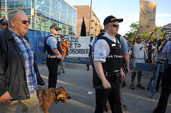 A veteran of the 1968 Democratic National Convention riots heckles demonstrators with a small group of other mainly retired officers who turned out for the 1968 Riot Cops Reunion at the Fraternal Order of Police headquarters in Chicago, Illinois on June 26, 2009.  The small group of a hundred or so demonstrators were kept a block away from the reunion at the Fraternal Order of Police headquarters.
