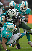 04.10.2015. Wembley Stadium, London, England. NFL International Series. Miami Dolphins versus New York Jets. Jets' Running Back Chris Ivory [#33] is tackled by the Dolphins defence.
