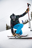 USA, Colorado, Aspen, a telemark skier puts on his skiis outside the Cloud Nine Restaurant, Aspen Highlands Ski Resort