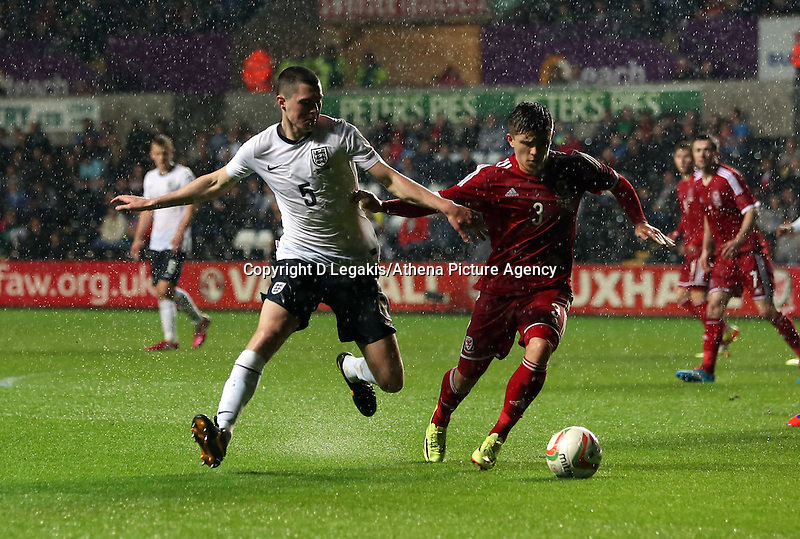 Pictured L-R: Michael Keane of England tries to get past Declan John of Wales. Monday 19 May 2014<br />