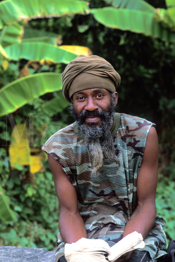 Old Reggae man with bible near Castle Bruce in Dominica.