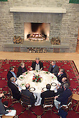 Shepherdstown, West Virginia - January 9, 2000 -- United States President Clinton, top center, hosts a Mideast peace talks dinner meeting between Prime Minister Ehud Barak of Israel, left, and Foreign Minister Farouk al-Sharaa of Syria, top right, and others in Shepherdstown, West Virginia, on 9 January 2000.  U.S. Secretary of State Madeleine Albright is at top left and National Security Adviser Samuel Berger is at right. This was the third face-to-face meeting between Barak and al-Sharaa during the peace talks. .Mandatory Credit: White House via CNP