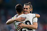 Gareth Bale of Real Madrid celebrates with teammate Marco Asensio Willemsen during the La Liga 2018-19 match between Real Madrid and Getafe CF at Estadio Santiago Bernabeu on August 19 2018 in Madrid, Spain. Photo by Diego Souto / Power Sport Images