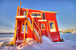 Bight pink houseboat faces the winter sunrise