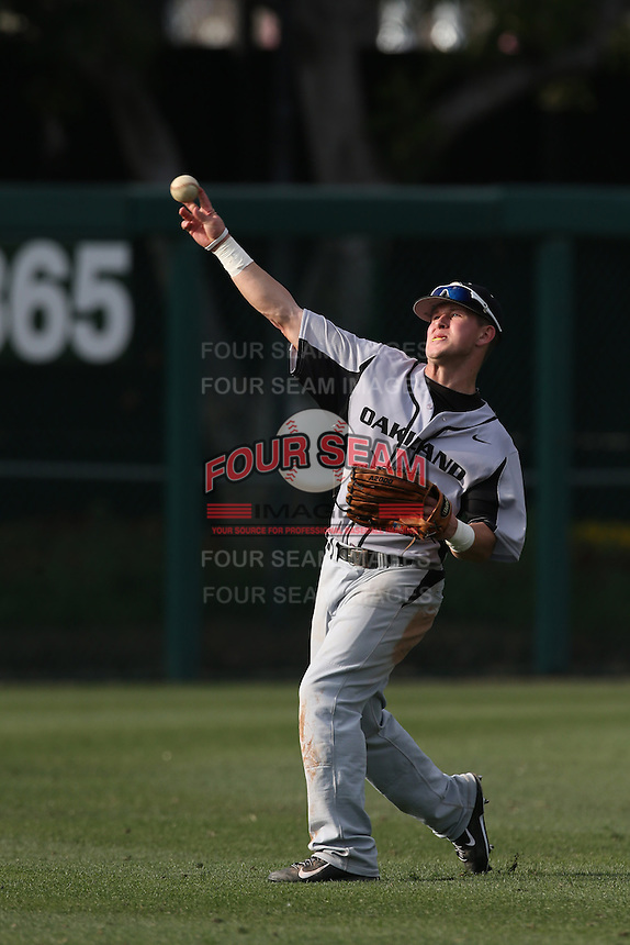 Trent Drumheller (1) of the Oakland Grizzlies throws between innings during a game against the Southern California Trojans at Dedeaux Field on February 21, 2015 in Los Angeles, California. Southern California defeated Oakland, 11-1. (Larry Goren/Four Seam Images)