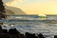 A lone wave turns a rich shade of emerald green as it crests, a little moment of zen at Ke'e Beach, Ha'ena State Park, Na Pali Coast, Kaua'i.