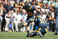 Giorgio Tavecchio kicks the extra point, held by Brock Mansion. The University of California Berkeley Golden Bears defeated the UC Davis Aggies 52-3 in their home opener at Memorial Stadium in Berkeley, California on September 4th, 2010.