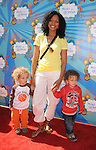 SANTA MONICA, CA. - March 14: Garcelle Beauvais-Nilon and her children attend the Make-A-Wish Foundation's Day of Fun hosted by Kevin & Steffiana James held at Santa Monica Pier on March 14, 2010 in Santa Monica, California.