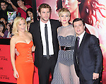 LOS ANGELES, CA - NOVEMBER 18: Elizabeth Banks, Liam Hemsworth , Jennifer Lawrence and Josh Hutcherson arrives at   THE HUNGER GAMES: CATCHING FIRE L.A. Premiere held at Nokia Live  in Los Angeles, California on November 18,2012                                                                               © 2013  Hollywood Press Agency