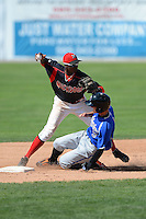 Batavia Muckdogs shortstop Javier Lopez (35) attempts to turn a double play as Jared Breen (9) slides in during a game against the Aberdeen Ironbirds on August 11, 2013 at Dwyer Stadium in Batavia, New York.  Batavia defeated Aberdeen 7-3.  (Mike Janes/Four Seam Images)