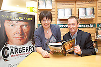 NO REPRO FEE.8/10/2011. Eason, Ireland's leading retailer of books, stationery, magazines and lots more, hosted a book signing by Jockey, Paul Carberry.  Pictured at Eason, O'Connell Street, Dublin is fan Pauline O Connell from Cork Paul Carberry who signed copies of his new autobiography One Hell of a Ride. Follow Eason on Twitter - @easons For further information, please contact: Aoife McDonald WHPR 087 4100777 . Picture James Horan/Collins Photos