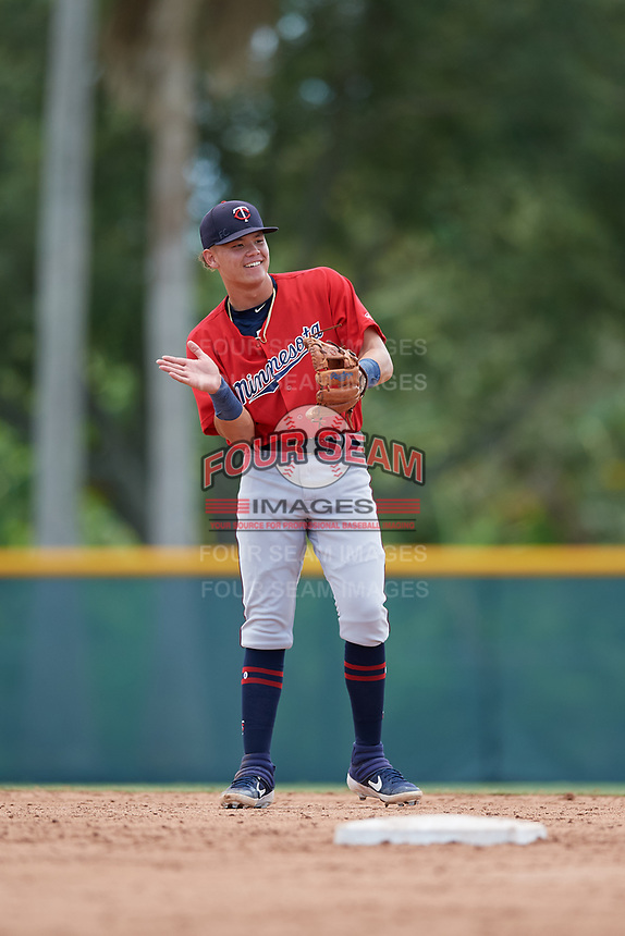 GCL Twins shortstop Keoni Cavaco (9) warming up in between innings during a Gulf Coast League game against the GCL Pirates on August 6, 2019 at Pirate City in Bradenton, Florida.  GCL Twins defeated the GCL Pirates 1-0 in the second game of a doubleheader.  (Mike Janes/Four Seam Images)