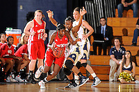 28 January 2012:  FIU guard Kamika Idom (14) defends WKU guard Alexis Govan (21) in the second half as the FIU Golden Panthers defeated the Western Kentucky University Hilltoppers, 60-56, at the U.S. Century Bank Arena in Miami, Florida.