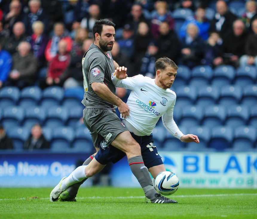Preston North End's Joe Garner is tackled by Rotherham United's Craig Morgan <br /> <br /> Photographer Chris Vaughan/CameraSport<br /> <br /> Football - The Football League Sky Bet League One Play-Off First Leg - Preston North End v Rotherham United - Saturday 10th May 2014 - Deepdale - Preston<br /> <br /> &copy; CameraSport - 43 Linden Ave. Countesthorpe. Leicester. England. LE8 5PG - Tel: +44 (0) 116 277 4147 - admin@camerasport.com - www.camerasport.com