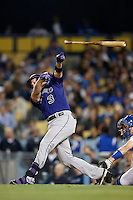 Michael Cuddyer #3 of the Colorado Rockies loses his bat while bat ing against the Los Angeles Dodgers at Dodger Stadium on April 30, 2013 in Los Angeles, California. (Larry Goren/Four Seam Images)