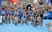 01 SEP 2007 - HAMBURG, GER - Ricarda Lisk (GER) leads a group into transition - Elite Womens World Triathlon Championships. (PHOTO (C) NIGEL FARROW)