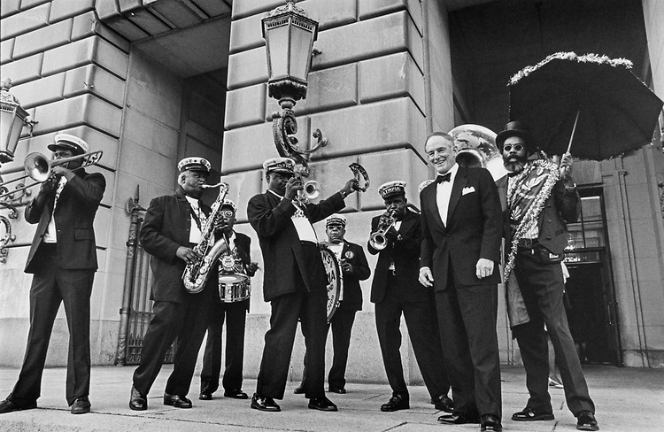 Sen. J. Bennett Johnston, D-La. arriving at his farewell party in the Andrew Mellon Auditorium.  Olympia jazz band, up from New Orleans for the event, greets him on Sept. 30, 1996. (Photo by Maureen Keating/CQ Roll Call)