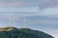 Three wind generators whirl on top of Pillar mountain near the city of Kodiak, Kodiak Island, Alaska.