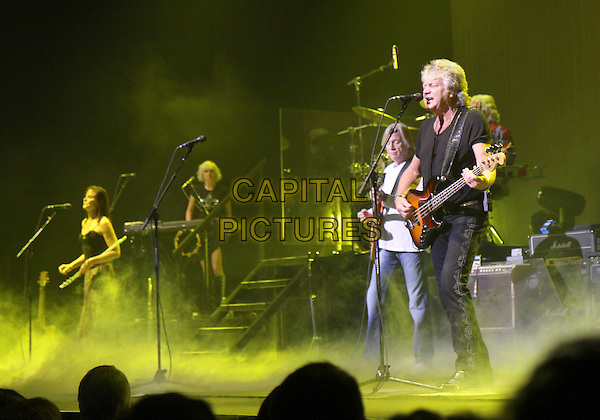 THE MOODY BLUES - Justin Hayward, John Lodge.performed at The Historic Fox Theater as part of their North American 2010 Tour, Atlanta, GA, USA, March 19th, 2010..music concert gig band live on stage full length guitar black t-shirt top playing white jeans  microphone singing .CAP/ADM/DH.©Dan Harr/Admedia/Capital Pictures
