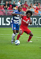 July 24, 2010 FC Dallas forward Jeff Cunningham #9 and Toronto FC midfielder Julian de Guzman #6 in action during a game between FC Dallas and Toronto FC at BMO Field in Toronto..Final score was 1-1.