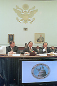 Former Democratic fund raiser John Huang testifies before the U.S. House Government Operations Committee to answer charges he arrange nearly one million dollars in illegal contributions for the Clinton-Gore re-election campaign in 1996 on 15 December, 1999.  He is flanked by his lawyers Mr. Kenney (left) and Mr. Cobb (right).<br /> Credit: Ron Sachs / CNP