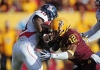 Nov. 28, 2009; Tempe, AZ, USA; Arizona Wildcats wide receiver (19) William Wright gets hit by Arizona State Sun Devils cornerback (12) LeQuan Lewis at Sun Devil Stadium. Arizona defeated Arizona State 20-17. Mandatory Credit: Mark J. Rebilas-