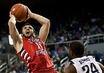 January 21, 2012:   Fresno State Bulldogs #12 Steven Shepp shoots over Nevada Wolf Pack guard Deonte Burton in the first half of their NCAA game played at Lawlor Events Center in Reno, NV.