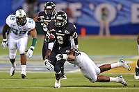 20 December 2011:  FIU running back Kedrick Rhodes (9) attempts to break away from Marshall linebacker Devin Arrington (25) while carrying the ball in the first quarter as the Marshall University Thundering Herd defeated the FIU Golden Panthers, 20-10, to win the Beef 'O'Brady's St. Petersburg Bowl at Tropicana Field in St. Petersburg, Florida.