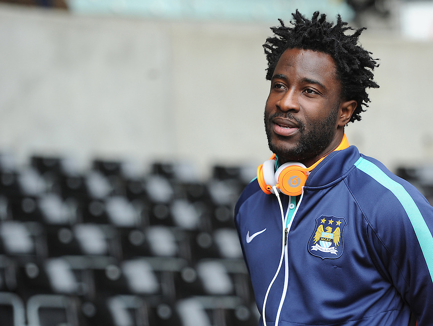 Manchester City's Wilfred Bony arrives at the liberty stadium<br /> <br /> Photographer Ashley Crowden/CameraSport<br /> <br /> Football - Barclays Premiership - Swansea City v Manchester City - Sunday 17th May 2015 - Liberty Stadium - Swansea<br /> <br /> &copy; CameraSport - 43 Linden Ave. Countesthorpe. Leicester. England. LE8 5PG - Tel: +44 (0) 116 277 4147 - admin@camerasport.com - www.camerasport.com
