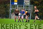Pa Joy Laune Rangers is tackled by Greg Horan and Denis McElligott during their Senior football relegation play off in Killarney on Sunday