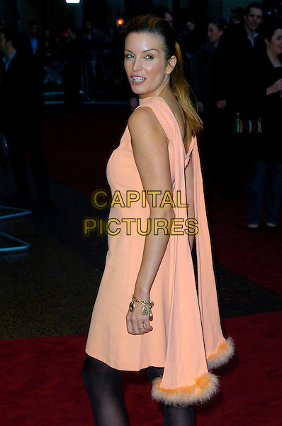 "CATALINA GUIRADO.Attending the UK Premiere of ""Shooter"",.Odeon West End,London, England,.March 29th 2007..half length peach orange dress black tights fur fluffy trim back behind over shoulder.CAP/CAN.©Can Nguyen/Capital Pictures"